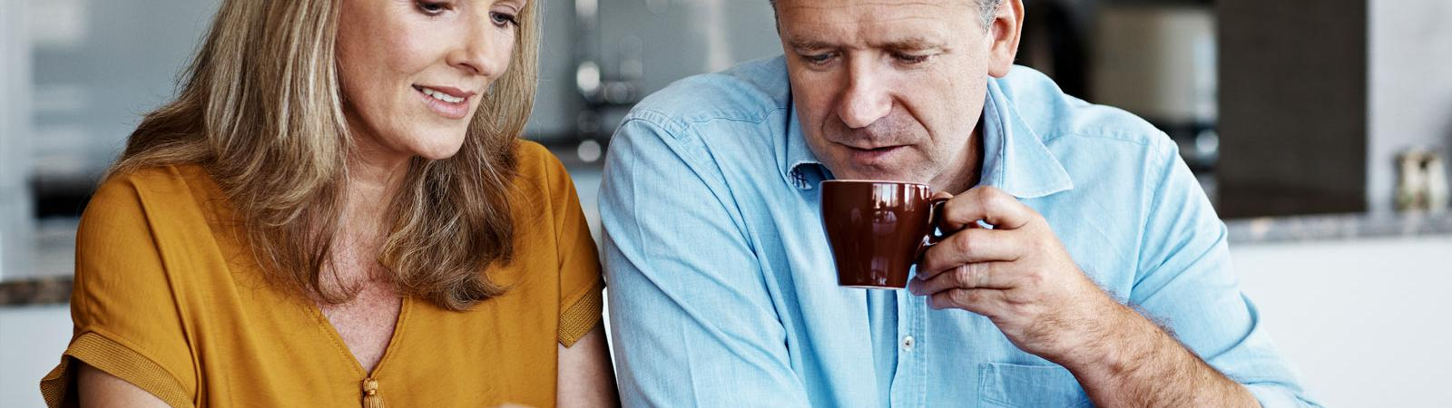 Couple reviewing finances at dining table